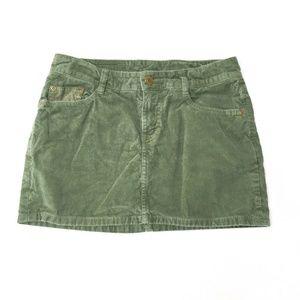 Label of graded goods H & M green cord mini skirt